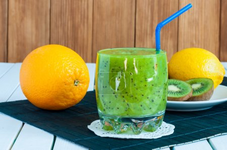 Photo for Delicious array of fruit juices served in glass made from liquidised kiwifruit and fresh orange, lemon for healthy summer treats rich in vitamins - Royalty Free Image