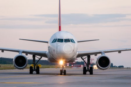 Photo for Airplane ready to take off from runway. A big passenger or cargo aircraft, airline. Transport, transportation, travel - Royalty Free Image