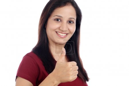 Young Indian showing thumbs up