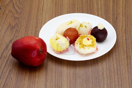 Indian sweets and apple