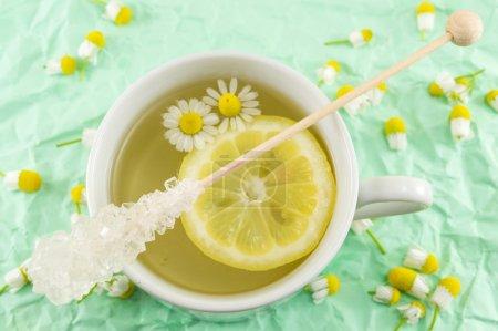 Chamomile tea with lemon slice and flowers