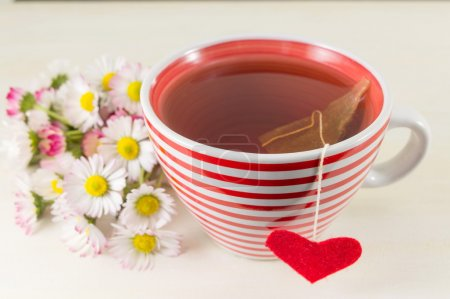 Chamomile tea with fresh flowers bouquet