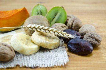 Dried figs, palms, pumpkins, wheat with walnuts and kiwis