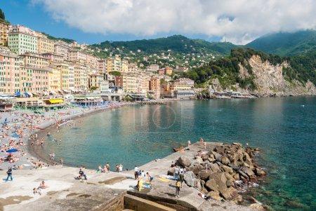 CAMOGLI, ITALY - JUNE 5 2016: Crowd in the beach of Camogli, near Genoa, during a sunny sunday afternoon