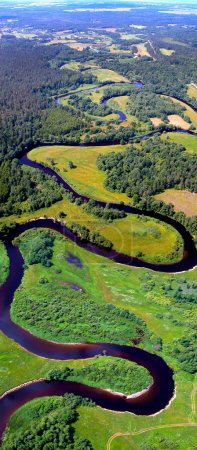 Green landscape view of the winding river from abo...