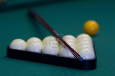 Russian billiards on green background.