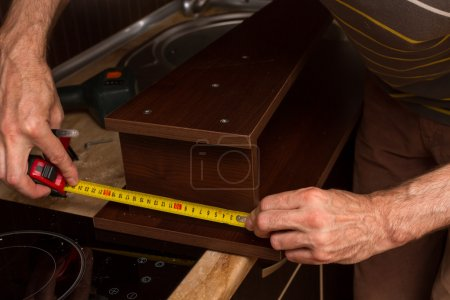 Roulette in the hands of builder of furniture.