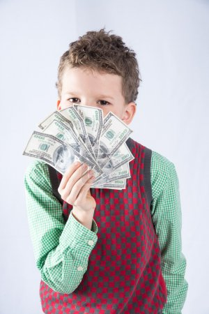 Photo for Boy holding a stack of hundred dollar bills - Royalty Free Image