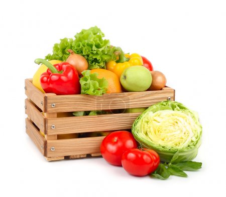 Fresh vegetables and fruit in a wooden box on a wh...