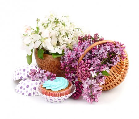 Photo for Lilac in a basket and cake on a white background. - Royalty Free Image