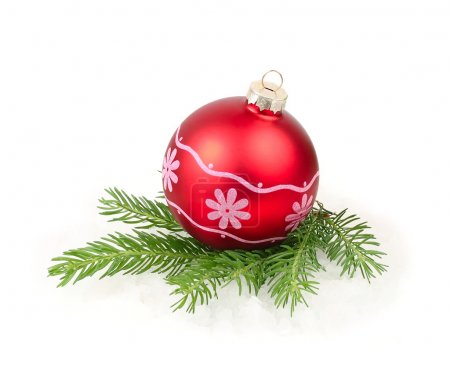 Red Christmas ball on a branch of a Christmas tree on a white background. A Christmas background with a place for the text.