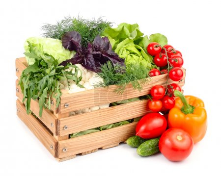 Photo for Fresh ripe vegetables in a wooden box on a white background with a place for the text. - Royalty Free Image