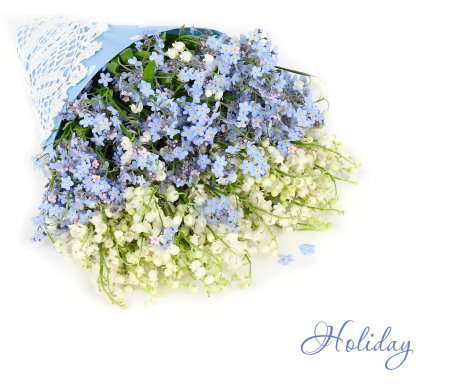 Bunch of forget-me-nots and lilies of the valley on a white background. A festive background with a place for the text.