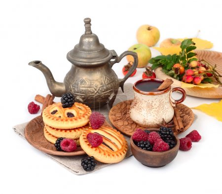 Autumn breakfast with coffee, berry cookies, raspberry and blackberry on a white background. An autumn background with a place for the text.