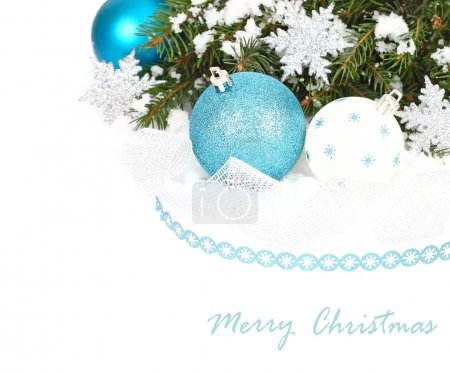 Blue and white Christmas balls and silvery snowflakes on a white background. A Christmas background with a place for the text.
