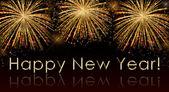 Šťastný nový rok text na pozadí ohňostroje