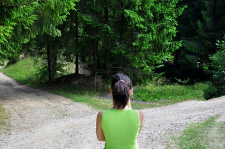 Photo for Girl with a choice near the forked road - Royalty Free Image