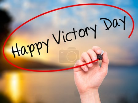 Man Hand writing Happy Victory Day with black marker on visual s