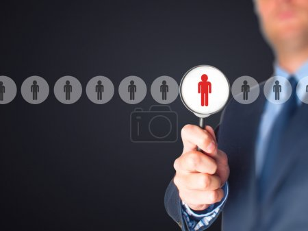 Photo for Networking and recruitment - Businessman with magnifying glass. Human resources, CRM, data mining, assessment center and social media concept - officer looking for employee represented by icon. - Royalty Free Image