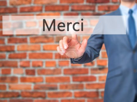 Photo for Merci - Businessman hand pressing button on touch screen interface. Business, technology, internet concept. Stock Photo - Royalty Free Image