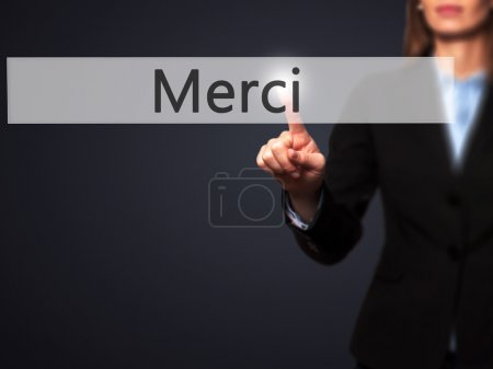 Photo for Merci - Businesswoman hand pressing button on touch screen interface. Business, technology, internet concept. Stock Photo - Royalty Free Image