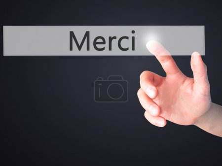 Photo for Merci - Hand pressing a button on blurred background concept . Business, technology, internet concept. Stock Photo - Royalty Free Image