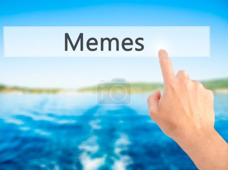 Memes - Hand pressing a button on blurred background concept on