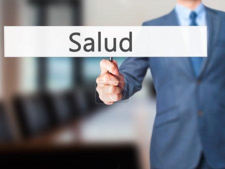Salud - Businessman hand holding sign