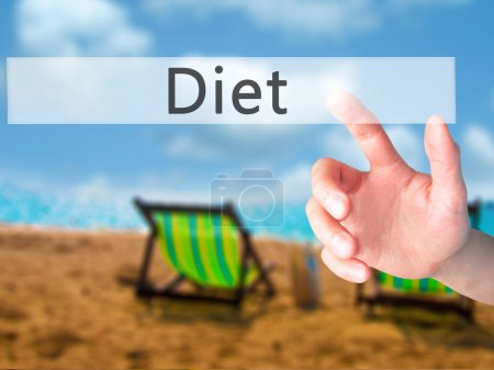Diet - Hand pressing a button on blurred background concept on v