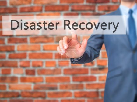 Disaster Recovery - Businessman hand pushing button on touch scr