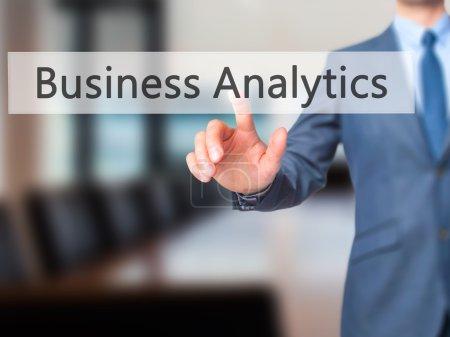Business Analytics -  Businessman click on virtual touchscreen.