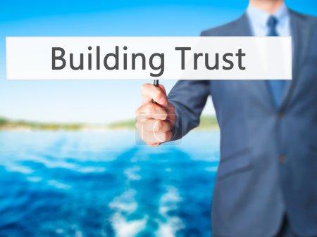 Building Trust - Businessman hand holding sign