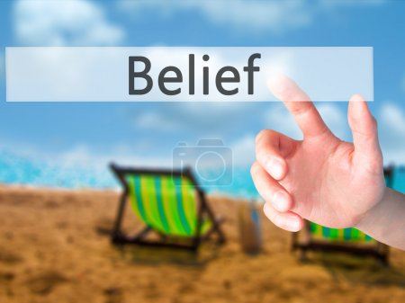 Belief - Hand pressing a button on blurred background concept on