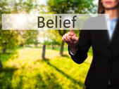 Belief - Successful businesswoman making use of innovative techn
