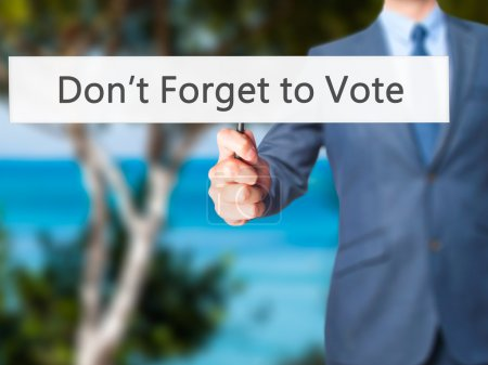 Don't Forget to Vote - Businessman hand holding sign