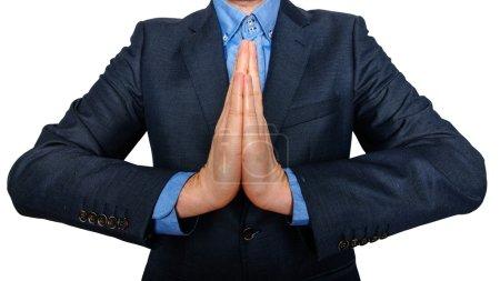 Photo pour Homme d'affaires, priant pour le succès. entreprise et bureau, gens concept - prier le jeune homme d'affaires. Fond blanc - image libre de droit
