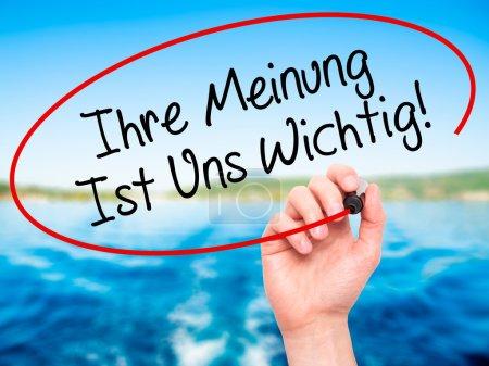 Man Hand writing Ihre Meinung Ist Uns Wichtig! (Yo...