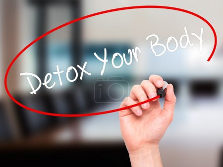 Man Hand writing Detox Your Body with black marker on visual scr