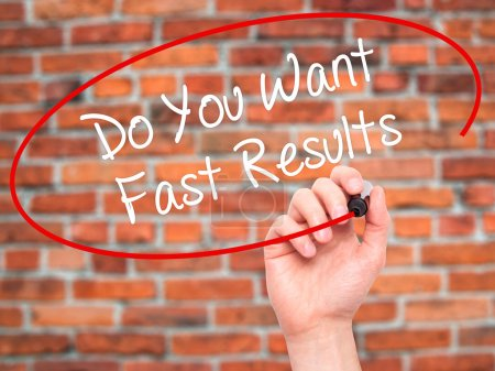 Man Hand writing Do You Want Fast Results with black marker on v