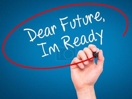 Man Hand writing Dear Future, Im Ready with black marker on visu