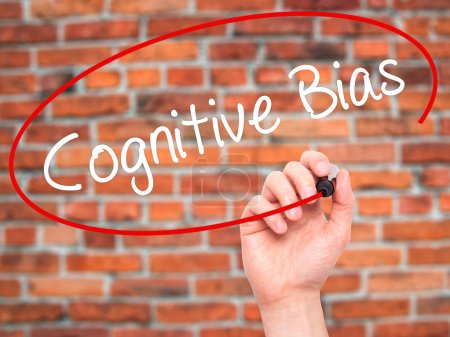 Photo for Man Hand writing Cognitive Bias with black marker on visual screen. Isolated on background. Business, technology, internet concept. Stock Photo - Royalty Free Image