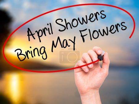 Photo for Man Hand writing April Showers Bring May Flowers with black marker on visual screen. Isolated on nature. Business, technology, internet concept. Stock Photo - Royalty Free Image