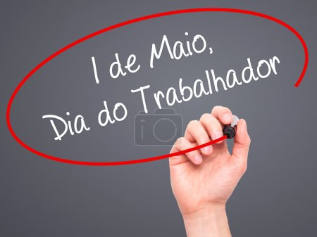 Man Hand writing  1 de Maio, Dia do Trabalhador (In Portuguese: