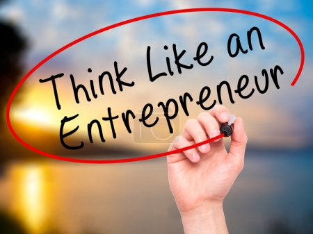 Man Hand writing Think Like an Entrepreneur with black marker on