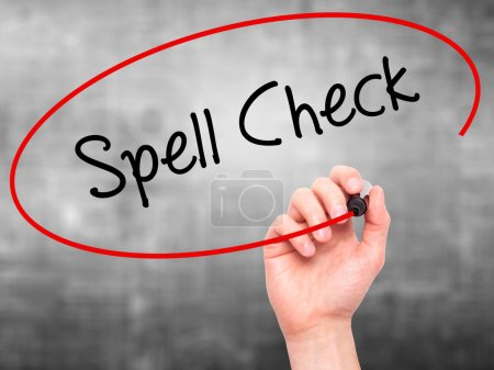 Man Hand writing Spell Check  with black marker on...