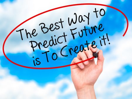 Man Hand writing The Best Way to Predict Future is To Create it!
