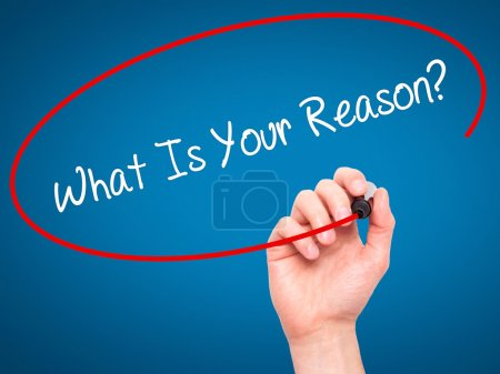 Man Hand writing What Is Your Reason? with black marker on visua