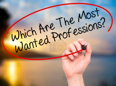 Man Hand writing Which Are The Most Wanted Professions? with bla