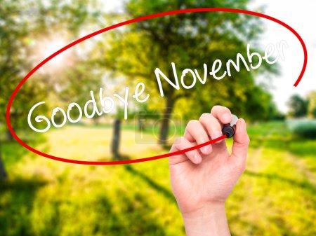 Man Hand writing Goodbye November with black marker on visual sc