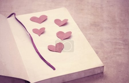 Paper hearts on a book